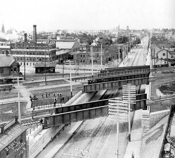 Photo taken above where The Rhino is now, looking east. The Gladstone Hotel in the middle, beyond bridges, is being built. 1889.